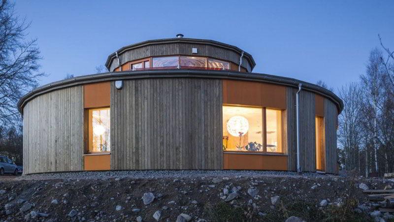 Casa com Fachada Redonda de Madeira