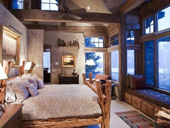 Quarto com decoração rústica e cama diferente.