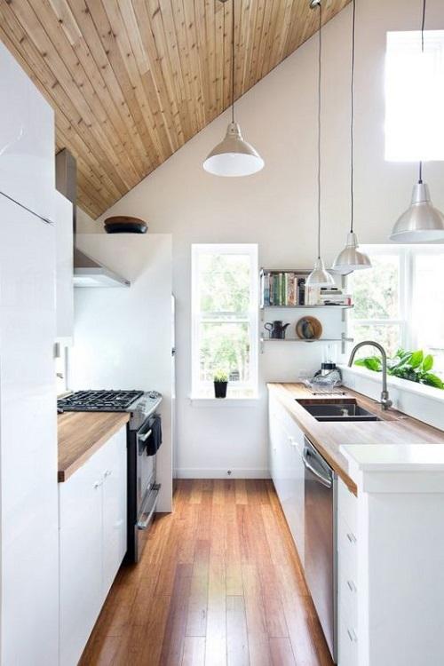 O teto de madeira também pode ser uma boa aposta na cozinha.